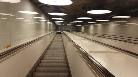 estocolmo : Footage of a long empty subway escalator going down underground