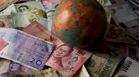 renminbi : FHD 29.97FPS footage of Foreign Banknotes Spinning Globe Worldwide World Currency Banking Graded Slow Motion