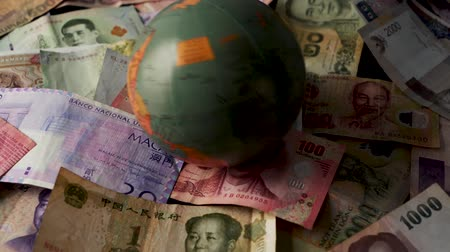 renminbi : FHD 29.97FPS footage of Foreign Currency Spinning Globe World Trade World Currency Money Exchange Graded Stationary