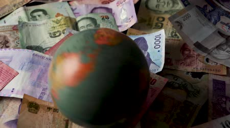 renminbi : FHD 29.97FPS footage of Foreign Banknotes Spinning World International Finance World Currency Trade War Graded Stationary Stock Footage