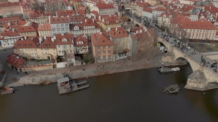charles bridge : Prague, Czech Republic - March 9, 2019: Aerial Drone footage of city center buildings and roof tops on the Prague skyline Czech Republic