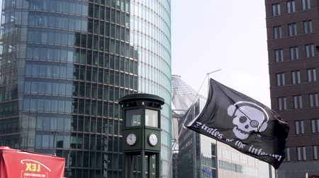 slogan : Berlin, Germany - March 23, 2019: Pirate of the Internet flag flying at Demonstration against EU Internet copyright reform  article 11 and article 13 in Berlin Germany