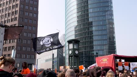 political speech : Berlin, Germany - March 23, 2019: Pirate of the Internet flag flying at Demonstration against EU Internet copyright reform  article 11 and article 13 in Berlin Germany