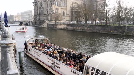 pitka : Berlin, Germany - March 23, 2019: View of Tourist Boat at Palace and Embankment on the River Spree in Berlin City