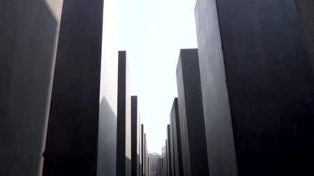 üldözés : Berlin, Germany - March 23, 2019: Footage from Holocaust Memorial Berlin Germany Memorial to the Murdered Jews of Europe