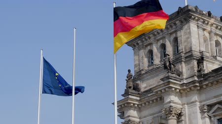 bundestag : Berlin, Germany - March 23, 2019: The German national flag flying in the wind together with the EU flag