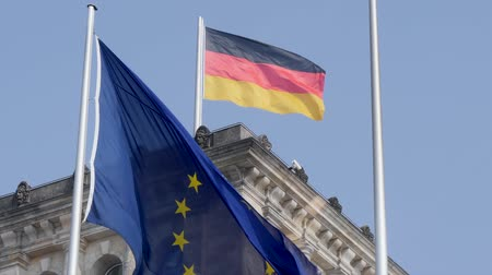 連邦政府の : Berlin, Germany - March 23, 2019: The German national flag flying in the wind together with the EU flag