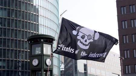 протест : Berlin, Germany - March 23, 2019: Pirate of the Internet flag flying at Demonstration against EU Internet copyright reform  article 11 and article 13 in Berlin Germany