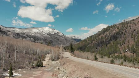 denver : Aspen, United States - April 19, 2019: Drone shot of scenic landscape of the rocky mountains, forests and snowy back roads near Aspen Colorado Stock Footage