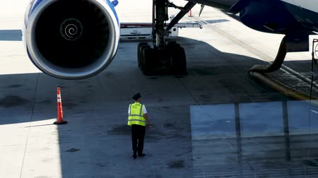 british aerospace : Las Vegas, United States - April 19, 2019: British Airways Captain flight crew inspects Boeing 777 plane and engine before flight from Las Vegas to London
