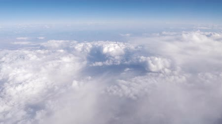 pencereler : Mid Flight, United States - April 19, 2019: View of flying above white clouds on commercial flight to Las Vegas USA. No Wing