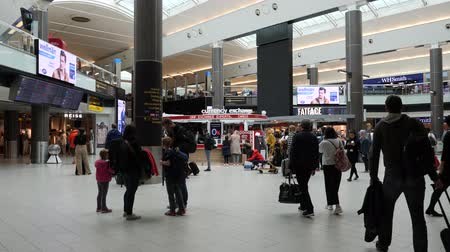 alaplap : London, United Kingdom - April 19, 2019: Families, Passengers and shoppers walking through London Gatwick Terminal, Shops and Restaurants in departure lounge