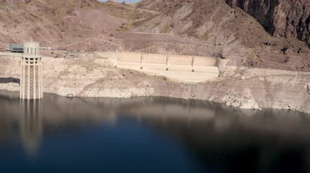 mead : Las Vegas, United States - April 19, 2019: PAN across the Hoover Dam, Colorado River, Lake Mead and Bridge
