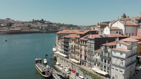 Porto, Portugal - September 1, 2019: 4k Drone Aerial PAN across the whole of Porto skyline and cityscape. Extra wide shot capturing the roof tops of the city and key attractions and landmarks Стоковые видеозаписи