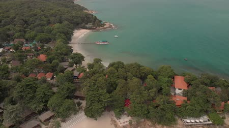 4k Aerial Drone Shot of Paradise Thai Island with Golden Sands and Turquoise Blue Water. Koh Samet is a popular as a tourist attraction and national park Стоковые видеозаписи