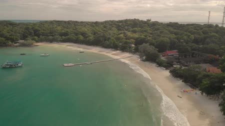 Koh Samet, Thailand - August 2, 2019: 4k Aerial Drone Shot of Paradise Thai Island with Golden Sands and Turquoise Blue Water. Koh Samet is a popular as a tourist attraction and national park Stock Footage