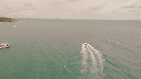 south east asia : 4k Aerial View Tourist Speed Boats taking people to and from the mainland to thai islands.