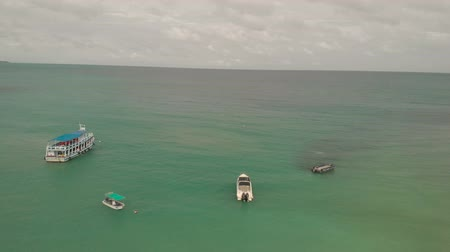 Koh Samet, Thailand - August 2, 2019: 4k Aerial View Tourist Speed Boats taking people to and from the mainland to thai islands. Koh Samet National Park. Golden Sand beach turquoise blue ocean sea.
