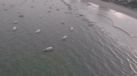 Pattaya, Thailand - August 2, 2019: 4k Drone Aerial view of speed boats in the sea off the coast of Pattaya Beach Chon Buri Thailand. Shot early morning just after sunrise along the coastline.