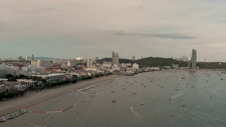 Pattaya, Thailand - August 2, 2019: 4k Drone Aerial Panning shot cross the Pattaya City skyline and cityscape. Drone flying over Pattaya city during early morning. Top Holiday destination Asia. Стоковые видеозаписи