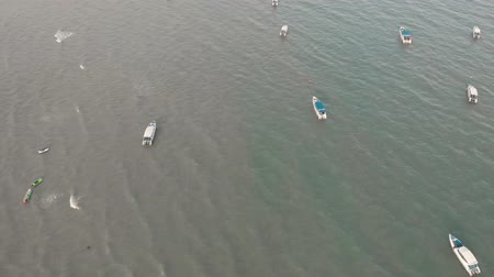 4k Drone Aerial view of speed boats in the sea off the coast of Pattaya Beach Chon Buri Thailand. Shot early morning just after sunrise along the coastline.