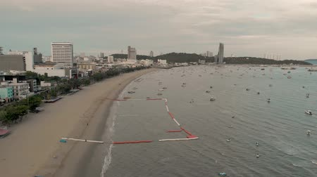 Pattaya, Thailand - August 2, 2019: 4k Early Morning Sunrise Drone Aerial view of Pattaya beach, Pattaya city, Thailand. Showing Thai speed boats and famous Pattaya Sign Stock Footage