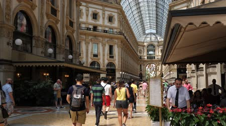 milan fashion : Milan, Italy - June 30, 2019: 4k Galleria Vittorio Emanuele II interior showing its ornate and luxury decor of this top shopping tourist attraction in Milano. Situated off the Piazza Del duomo.
