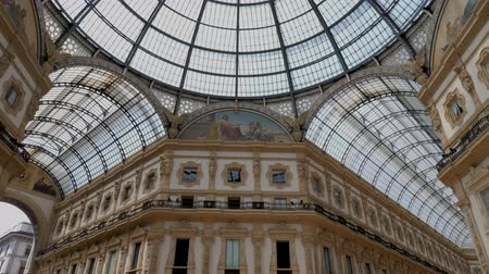piazza del duomo : Milan, Italy - June 30, 2019: 4k Galleria Vittorio Emanuele II interior showing its ornate and luxury decor of this top shopping tourist attraction in Milano. Situated off the Piazza Del duomo.