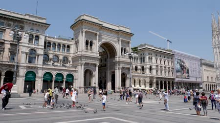 emanuele : Milan, Italy - June 30, 2019: 4k Slow Motion shot of Tourists visiting the Piazza del Duomo to see top tourist attractions the Duomo del Milano and shopping at Galleria Vittorio Emanuele II Milano