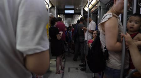 ambientalmente : Genoa, Italy - July 1, 2019: 4k Slow Motion close up face on shot inside Genoa underground subway train interior. Passengers and tourists riding on train. Stock Footage
