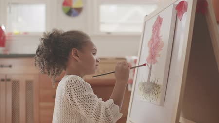 little : Little girl painting on a canvas Stock Footage