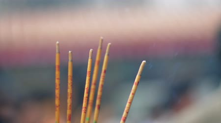 Closeup shot of joss sticks burning