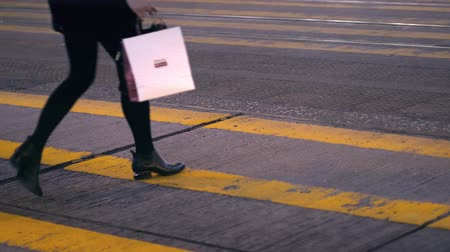 Female pedestrian crossing the street