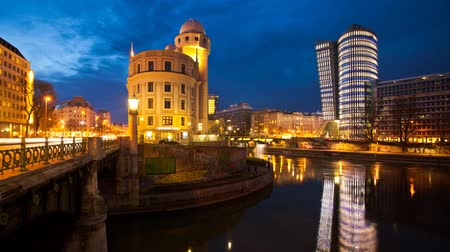 urania : Time lapse of the Danube Canal of Vienna. Right the new UNIQA-Tower and opposite the historic building Urania. Stock Footage