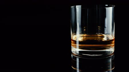 pálinka : Luxury whiskey poured to empty glass Stock mozgókép
