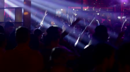ночная жизнь : Night Disco Party.  People dancing in a fashion disco club in Barcelona. Dancing party clubbing at night. Music and flash lights. Colorful flash lights in the discotheque.