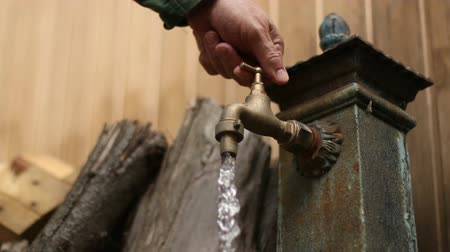 устойчивость : Old Faucet. Dripping Tap.  Old faucet dripping. Iron fountain. A man opens and closes the tap. A good clip for ecology, energy saving, sustainability, water waste, domestic economy or saving money ideas.