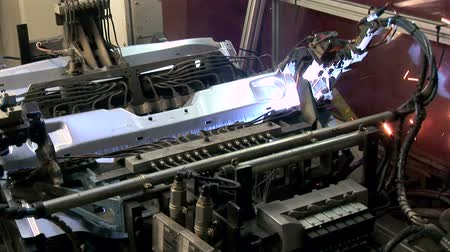 automobilový průmysl : Laser Welding Robot.  Industrial laser welding robot in an automotive factory. Good shot for industry production, automation, robotics, engineering or industrial equipment.