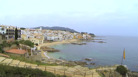 ryba : Aerial Drone Fishing Village.    Picturesque Mediterranean fishing village in la Costa Brava. Aerial drone shot flying over the rooftops to the old center of Calella de Palafrugell. Flying over turquoise beaches with a DJI Phantom.