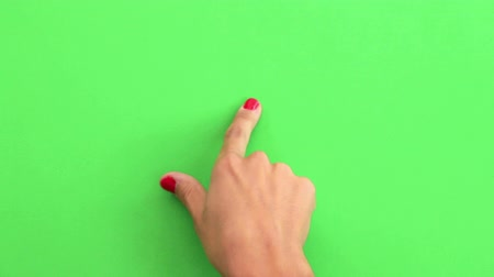 dokunaklı : Mobile Device Touch Screen Finger Gestures on Green.  A finger taps and swipes on a screen touch to simulate interacting with a mobile device. Green screen ready for chroma key.