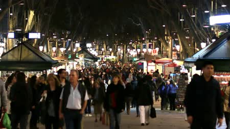 bazar : Barcelona Christmas Shopping Crowded Streets.  Tourists walking and shopping in Barcelona at Christmas time. Crowded Les Rambles Street at night. Crowds shopping in Barcelona. Crowds of people walking on the city streets.