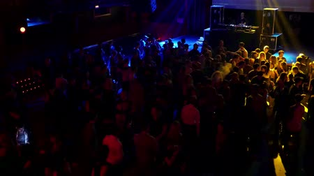 discotheque : Barcelona Night Disco Party Dj Session Sala Apolo.  People dancing in a fashion disco club in Barcelona. Crowds of people dancing in the party clubbing at night. Music and flash lights. Colorful flash lights in the discotheque. Stock Footage