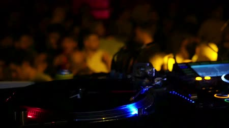 discotheque : Barcelona Night Disco Party Sala Apolo.  Turntable with people dancing in the background. People dancing in a fashion disco club in Barcelona. Dancing party clubbing at night. Music and flash lights. Colorful flash lights in the discotheque. Stock Footage