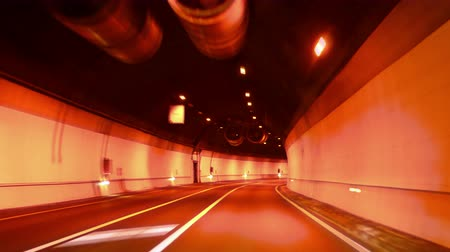 dinamik : Highway Red Tunnel Rage Camera Car at High Speed 4k.  Time lapse driving along the red tunnel at night. Gorgeous, high-energy roads time lapse.  Good for a video background. Great for any driving, corporate, city or urban ideas. Stok Video