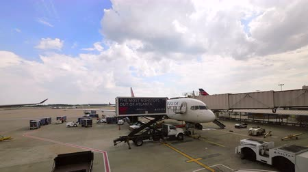 turbine : Commercial Airplane on the Gate at Atlanta Hartsfield-Jackson Airport.  Delta Airlines plane refueling and all airport services preparing flight. Video time lapse preparing the aircraft for next takeoff in the United States of America. Filling the tank of