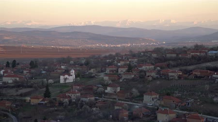 bułgaria : Scenic view of Slavyani village church with Lovech city in the background. Balkan mountain range in Bulgaria, evening light