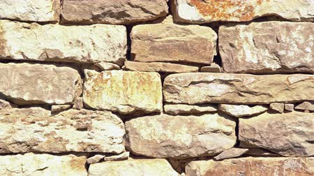 homeopático : Close up of old flat brown and gray stone wall texture. Layered rocks on a house or building. Architectural stone wall exterior typical in Bulgaria