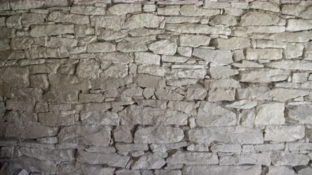 bolgár : Close up of old flat brown and gray stone wall texture. Layered rocks on a house or building. Architectural stone wall exterior typical in Bulgaria