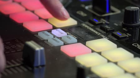 instrument maker : DJ beat maker pushing colourful buttons on the beat pad. Close up of mans fingers pressing buttons at music production studio Stock Footage