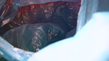 usado : Dolly shot through disposable plastic bag background. Transparent, reusable plastic waste. Plastic recycling, environmental issues Stock Footage